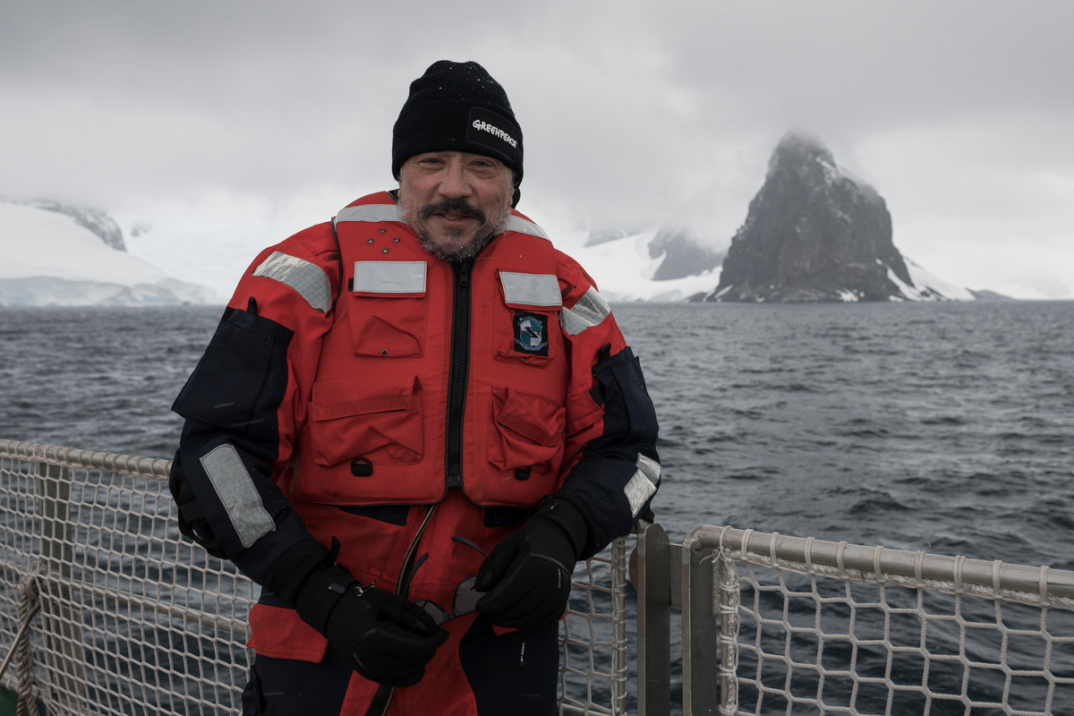 Actor and Antarctic ambassador Javier Bardem standing on the deck of Greenpeace ship the Arctic Sunrise looking out over the mountains and glaciers at Orne harbor in the Gerlache Strait. Greenpeace is on an expedition to support the creation of the largest protected area on Earth, an Antarctic Ocean Sanctuary.